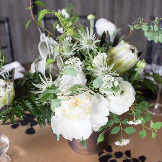 Wild green arrangement with peonies thistle jasmine and protea at the 1Hotel
