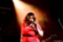Jj Thames performing red dress spotlight Bain de Blues festival 2016