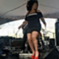 Jj Thames perfoming full body red high heel shoes