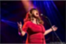 Jj thames performing in France red dress blonde hair