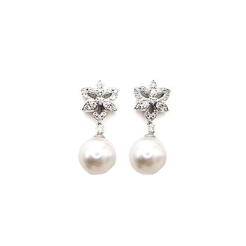 Boucle d'oreille or blanc diamants et perle
