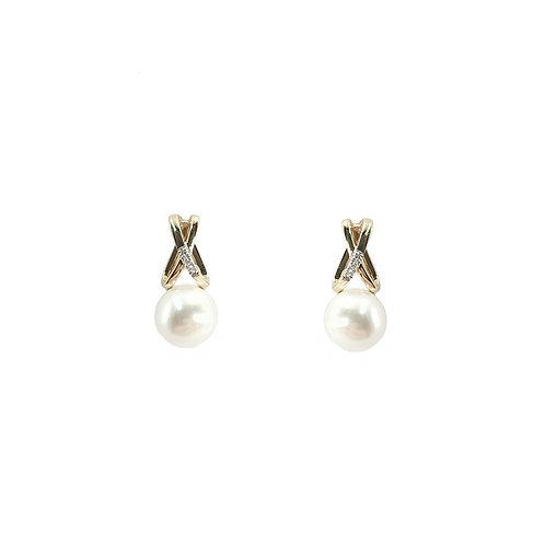 Boucle d'oreille perle et diamants