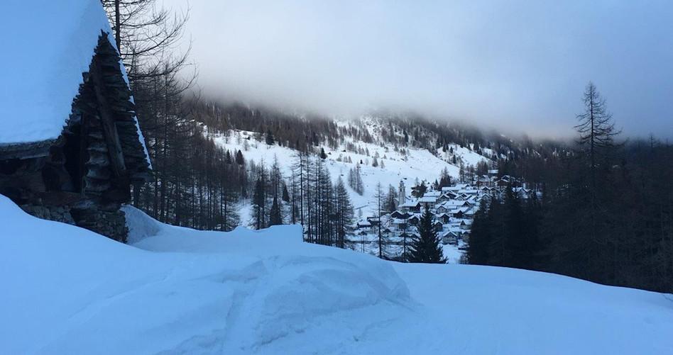 Bosco Gurin unter dem Nebel