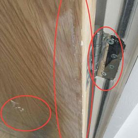 Door and door frame paint splashed.