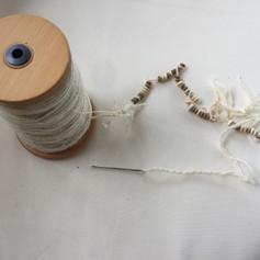 threading the beads.jpg