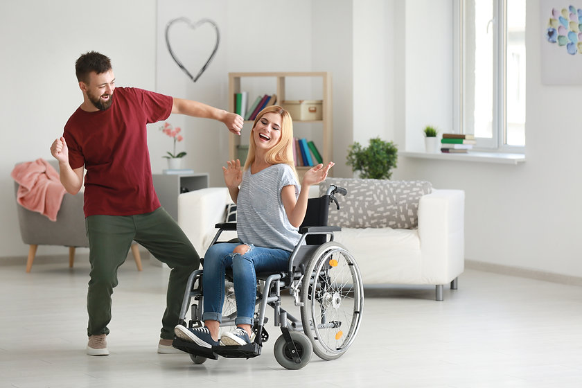 Beautiful woman in wheelchair with man d