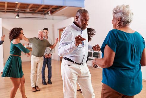 People Attending Dance Class In Community Center.jpg