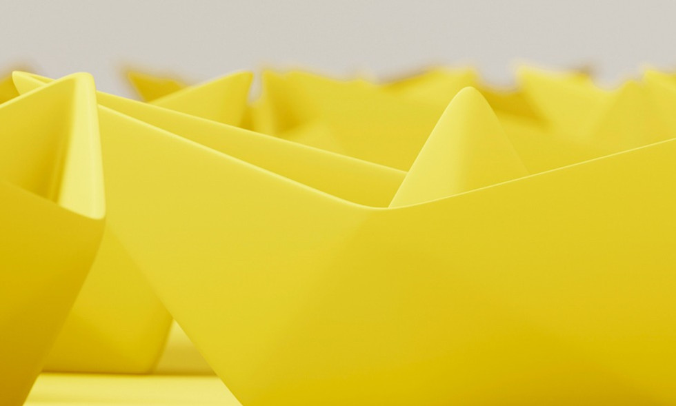 yellow-origami-paper-boat-white-surface-