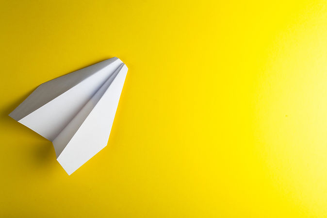 paper-airplane-yellow-surface.jpg