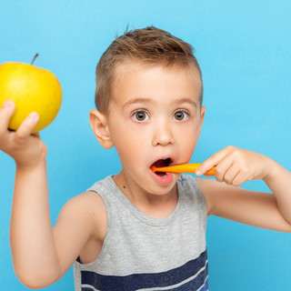 happy-blonde-kid-boy-smiling-with-apple-