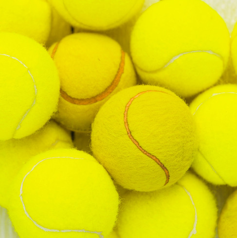 heap-green-tennis-balls-wooden-table.jpg
