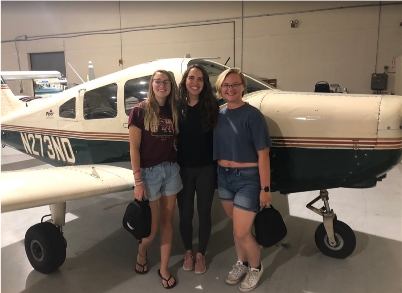 Taylor, Jenny, and Mae next to the plane we rode in