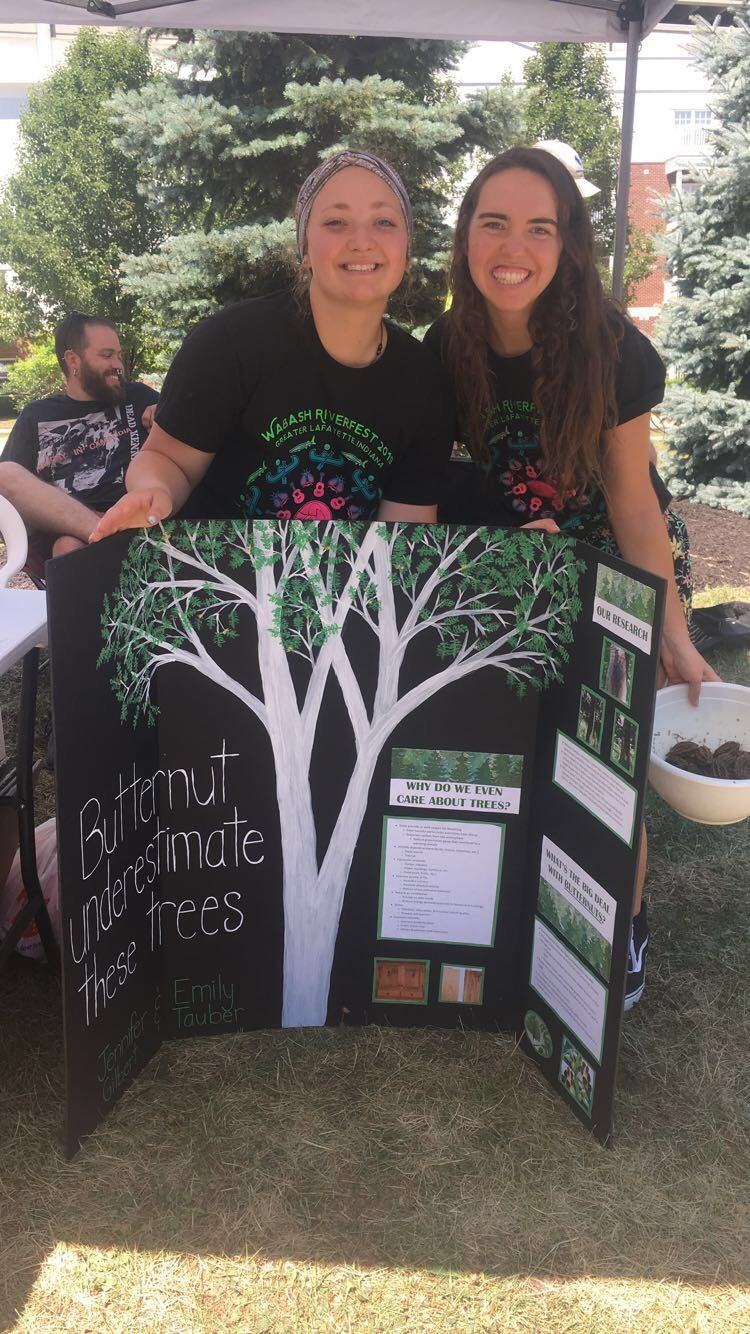 Emily and Jenny with their tree poster