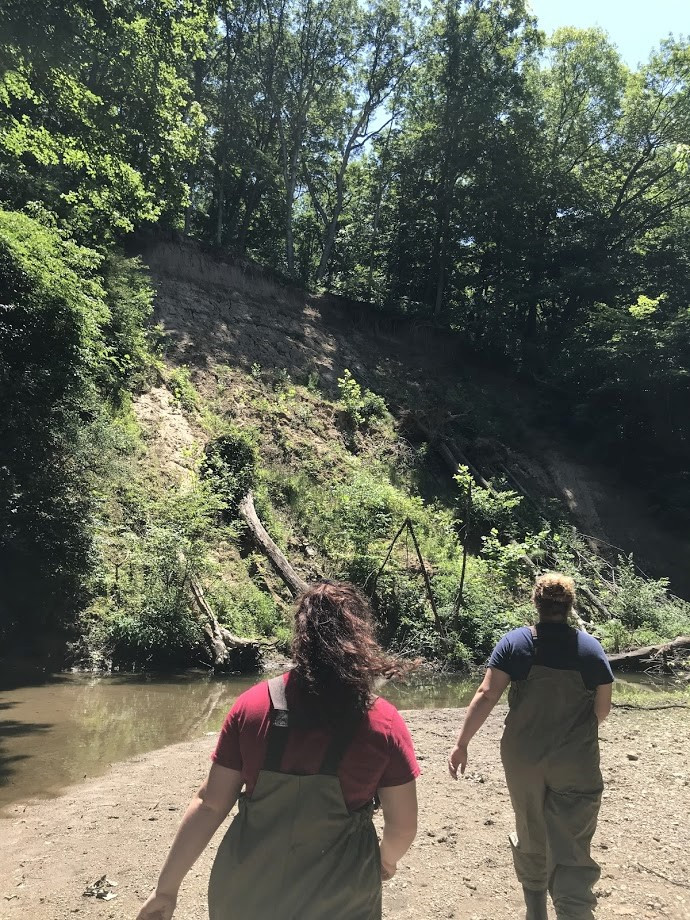 Avery and Emily walking in stream bed