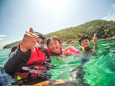 happy-family-snorkelling-in-a-tropical-e