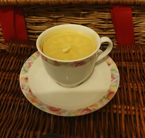 Candle in floral teacup, citrus scent