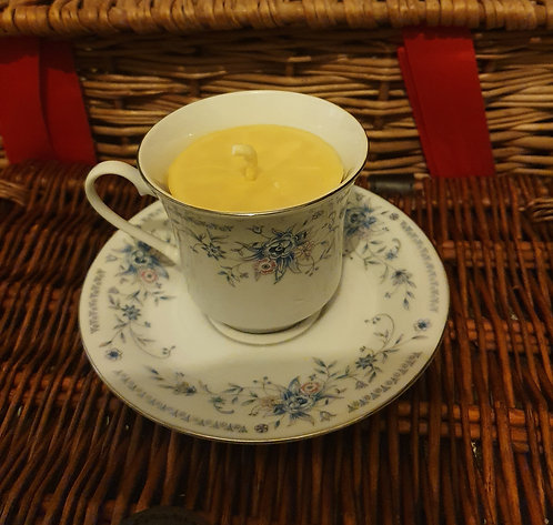 Candle in blue flowers teacup, citrus scent