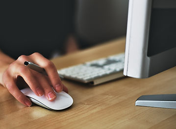 picture of a hand on a computer mouse