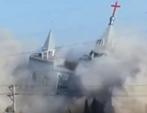 In China, a country ranking very high in governmental restrictions on Christians, BBC broadcast a Jan. 9 cellphone photo of the government bombing the mega Golden Lampstand Church in Shanxi, China. (Screen capture from BBC)