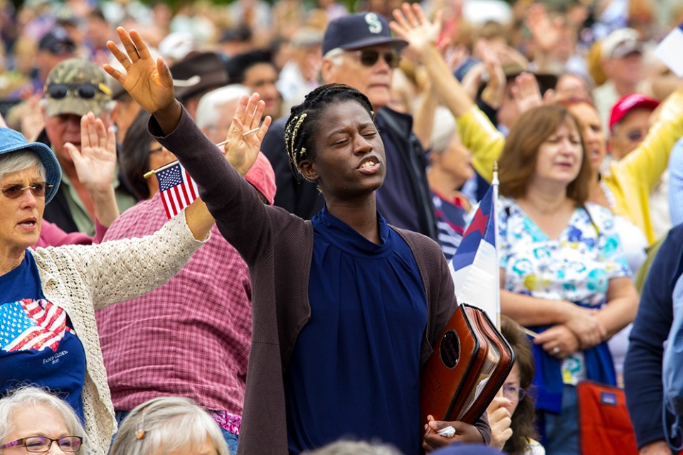 Some of those gathered worshiping in the Lord. (Photo courtesy Billy Graham Evangelistic Association)