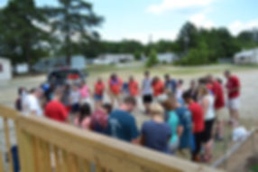Volunteers gather in a circle to pray following a day of ministry at the Countryside Mobile Home Park with the Hinsons.(Photo courtesy The Baptist Courier)