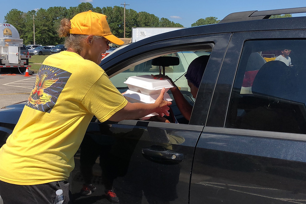 A Southern Baptist Disaster Relief team with the North Carolina Baptists on Mission provides hot meals for a resident in Lumberton, N.C., impacted by Hurricane Florence. (Photo by Brandon Elrod)