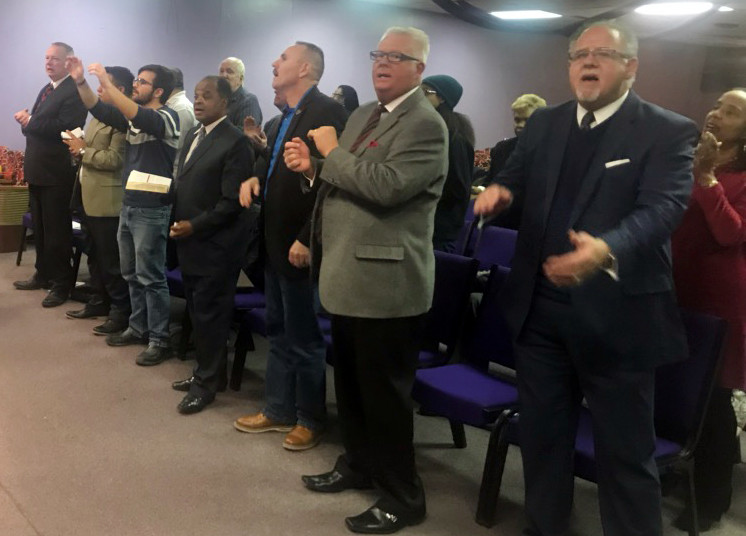 Tim Patterson (far right), executive director and treasurer of the Baptist State Convention of Michigan, praises God at a Jan. 21 worship service in Detroit commemorating the late Martin Luther King, Jr. (Photo from Roland Caldwell)