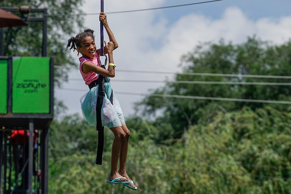 Ten-year-old Jasmine rides a zip line at a block party hosted by Sterling Baptist Church in Fairview Heights, Ill. The block party was part of Crossover St. Louis 2016, held prior to the annual meeting of the Southern Baptist Convention June 14-15 at America's Center in St. Louis. (Photo courtesy Matt Miller)
