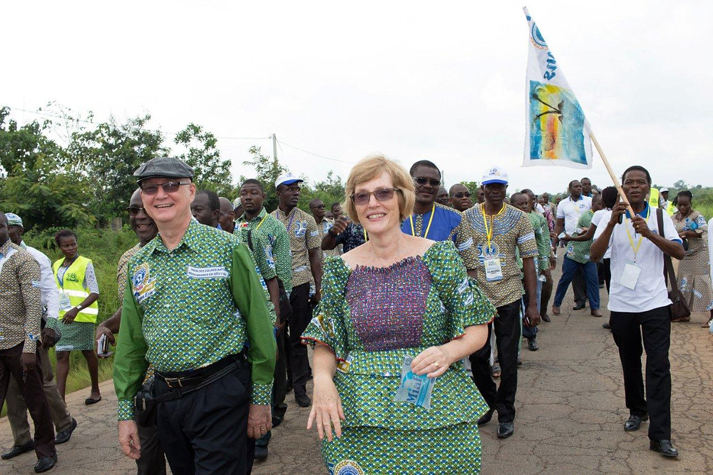 Randy and Kathy Arnett celebrate the 50th anniversary of Baptist work in Cote d'Ivoire in August 2016, walking about two miles to a seminary alongside fellow Christians. The Arnetts, who died March 14, were known for the joy they shared with African friends and colleagues. (IMB Photo by William Haun)