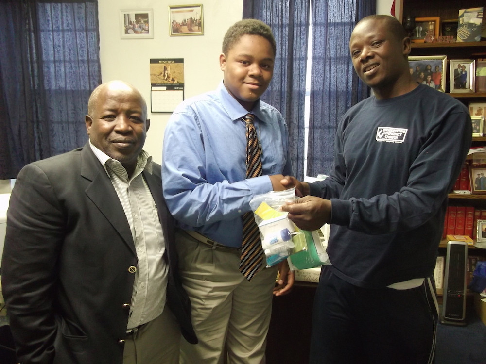 From left to Right: Missionary from Kenya African - Wachira Ngauma , Jacob Winston, youth from Faith Fellowship, Irungo from Kenya- Staff with PACE Ministries in Kenya African.  The two men from Kenya took the personal Hygiene Package back to Kenya from Faith Fellowship. (Photo courtesy Faith Fellowship Baptist Church)