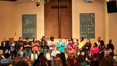 Women offering praise to our Lord at the Scars to Beauty conference. (Photo courtesy Warren Woods Baptist Church)