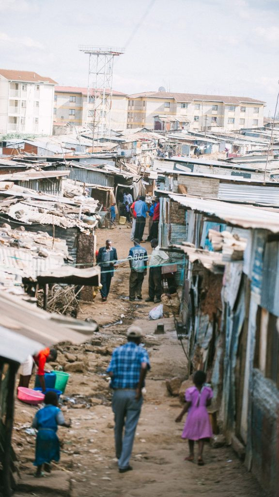 People amble around the Kibera slum in Nairobi, reportedly the largest urban slum in Africa. Population estimates range from a couple hundred thousand to a couple million people. All of Kibera's residents live in extreme poverty, earning less than $1 per day. (Photo by IMB)