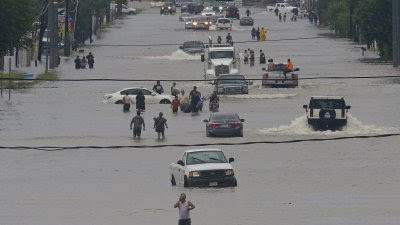 The people of the greater Houston area are forced to wade in floodwaters filled with wildlife, trash debris, and who knows what else. They need our prayers. (Photo courtesy FOXNEWS.com)