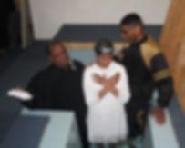 Pastor Stan Parker baptizes new convert Taylor. (Photo courtesy Faith Fellowship Baptist Church)
