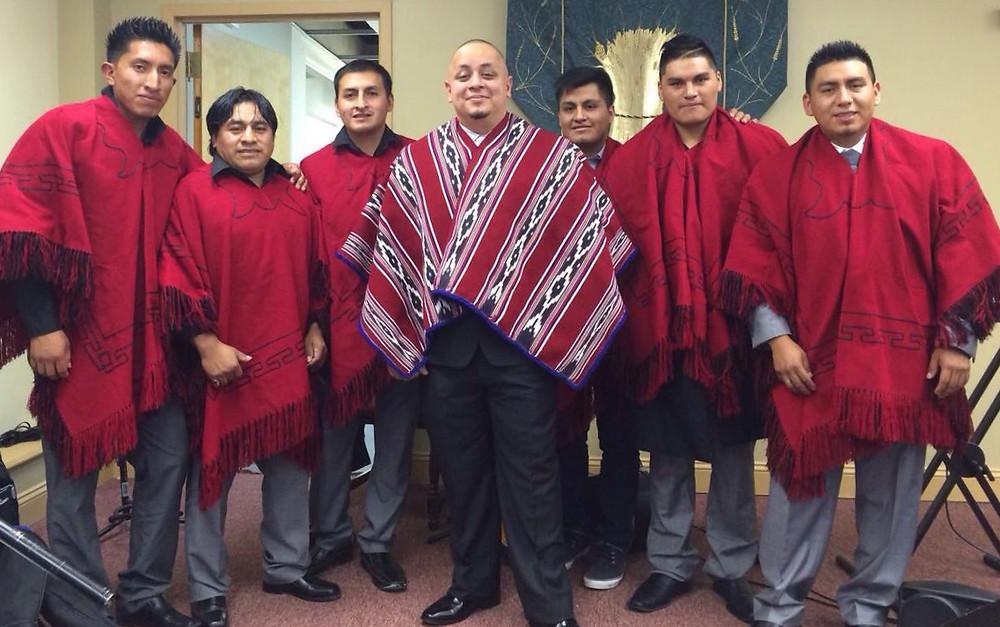 School custodian and church planter Alex Vargas (center) poses with members of Iglesia Cristiana Bautista Jesus de Nazaret, a new Quechuan congregation in Waterbury, Conn. (Photo by BCNE)