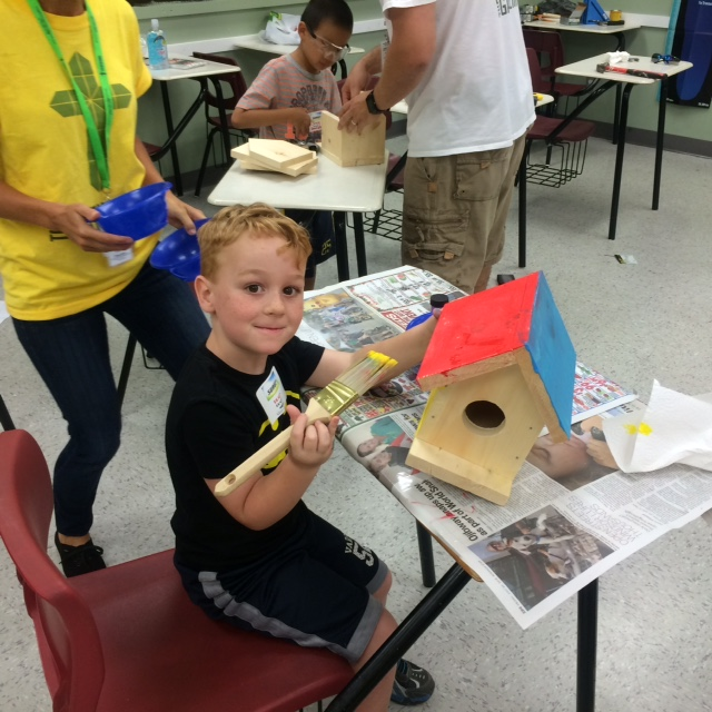 """Brady Dessureault puts the finishing touches on his birdhouse in the """"woodworking"""" option at SURGE Camp. (Photo courtesy Garth Leno)"""
