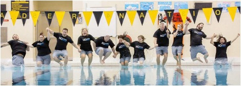 The Leadership Team at Storytellers takes a leap into the pool to represent the church taking a new leap of faith.  (Photo courtesy Storytellers Church)