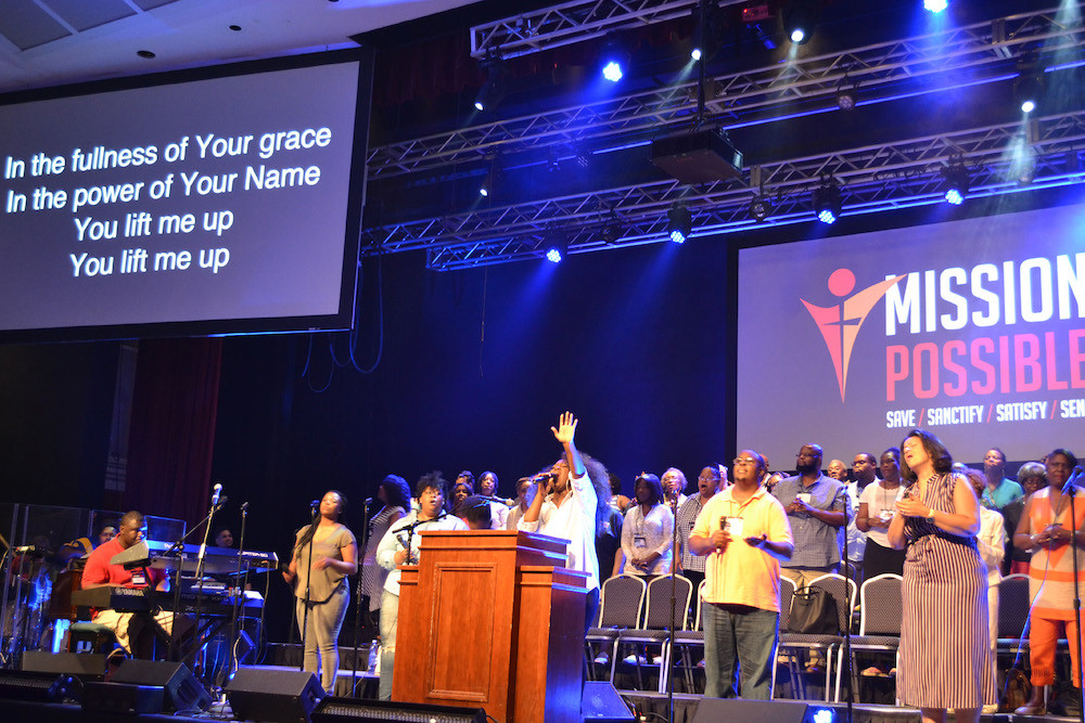 """Niya Cotton, at podium, leads the """"Who-So-Ever-Will"""" choir in praise and worship during the 2017 Black Church Leadership and Family Conference underway at Ridgecrest, N.C.  (Photo by Diana Chandler)"""