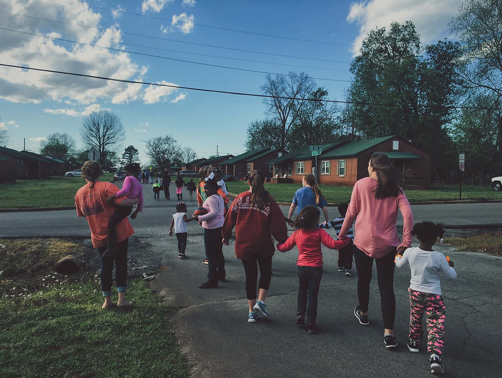 Volunteers participate in a weekly kids club held at Sheffield Homes, a multihousing complex in the Shoals area where Bryant McGee, multihousing strategist for the area, has helped start a 'missional community.' (Photo courtesy of The Alabama Baptist – www.thealabamabaptist.org)