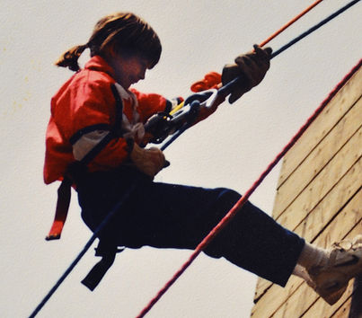 Maggie Sandusky is glad her parents didn't raise her as a boy, though she liked boy adventures, and still does, such as rappelling. (Photo courtesy Baptist Press)