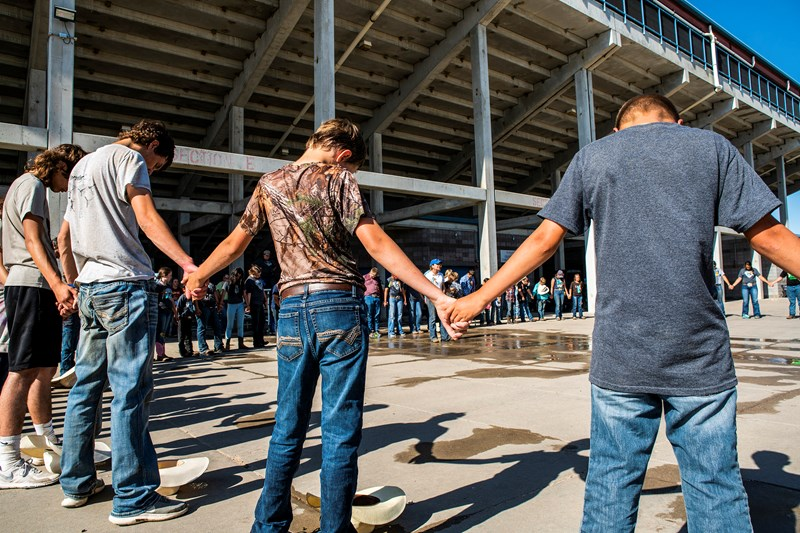 The circle of prayer is a tradition at rodeos, with cowboys circling the arena and joining hands in prayer. The Journey to the Cross Bible Camp keeps this tradition alive with a daily circle of prayer where campers pray for each other. (Photo by Sue Sprenkle)