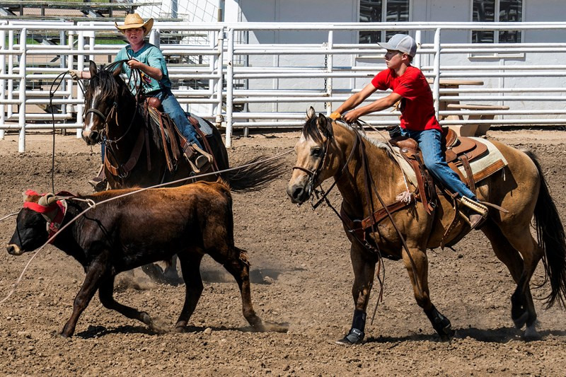 Junior team ropers practice in the arena at the Journey to the Cross Rodeo Bible Camp in Garden City, Kan. Campers focus on a rodeo event and participate in Bible studies, worship services and games. (Photo by Sue Sprenkle)