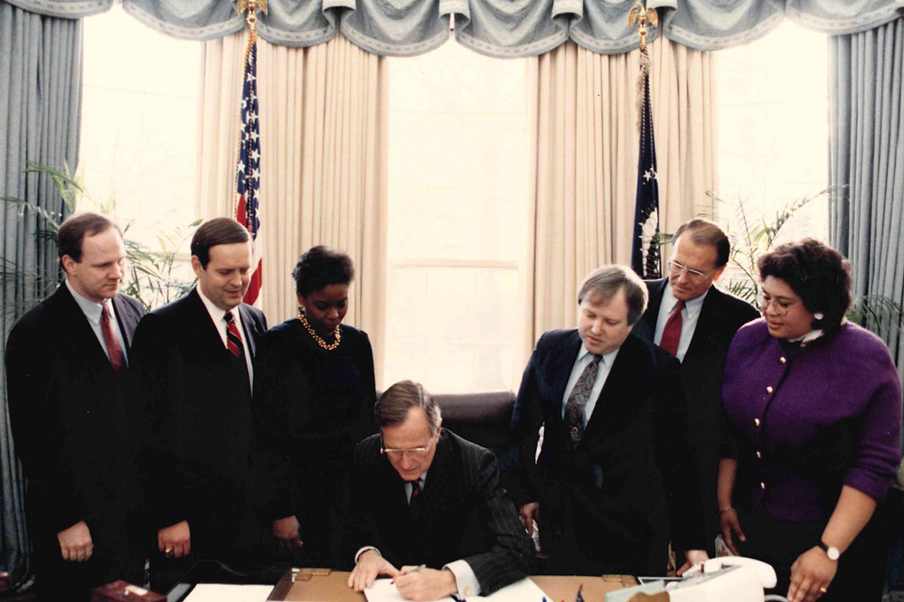 Richard Land (second from left), then-executive director of the SBC's Christian Life Commission, attends a December 1991 bill signing with President George H.W. Bush at the White House. (Photo courtesy of Richard Land.)