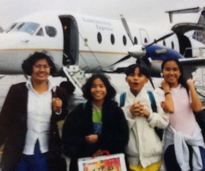 We made it! Our family arriving at our final destination on such a small plane. (Photo courtesy Aaron Tanap)