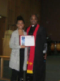 Taylor presented with Certificate of Baptism. (Photo courtesy Faith Fellowship Baptist Church)