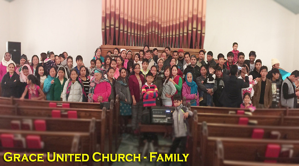"""These Nepalese immigrants reflect much of Grace United Church's membership, now the third-largest evangelical congregation in Burlington, Vt. The pastor, Buddha Rai, himself an immigrant, has led the church into cooperation with the Baptist Convention of New England to develop """"really strong, good connections with other churches here."""" (Photo by BCNE)"""