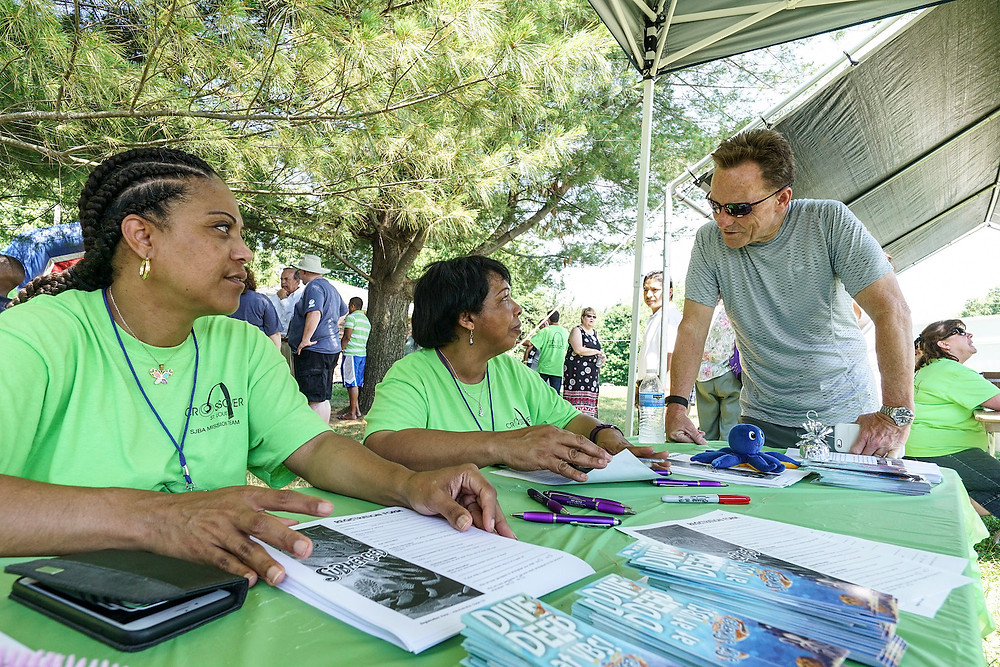 (Left to right) Catherine Corpus and Lina Freeman, members of Idlewild Baptist church in Lutz, Fla., visit with Ronnie Floyd, president of the Southern Baptist Convention, during a block party at Sterling Baptist Church in Fairview Heights, Ill. The block party was part of Crossover St. Louis 2016, held prior to the annual meeting of the Southern Baptist Convention June 14-15 at America's Center in St. Louis. (Photo courtesy Matt Miller)