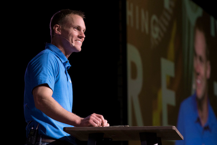 David Platt, president of the International Mission Board, speaks to 1,350 people who gathered at a dinner June 12 at the Phoenix Convention Center to celebrate what God is doing and how attendees can partner with them. (Photo by Matt Jones)