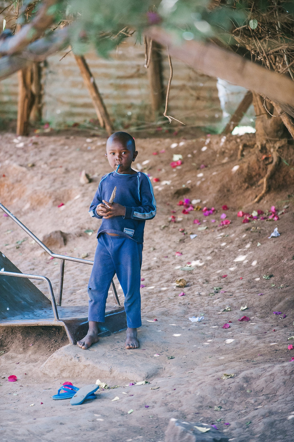 A boy plays with a piece of wood in the Dandora slums of Nairobi, Kenya. There are reportedly 2.5 million slum dwellers in about 200 settlements in Nairobi. (Photo by IMB)