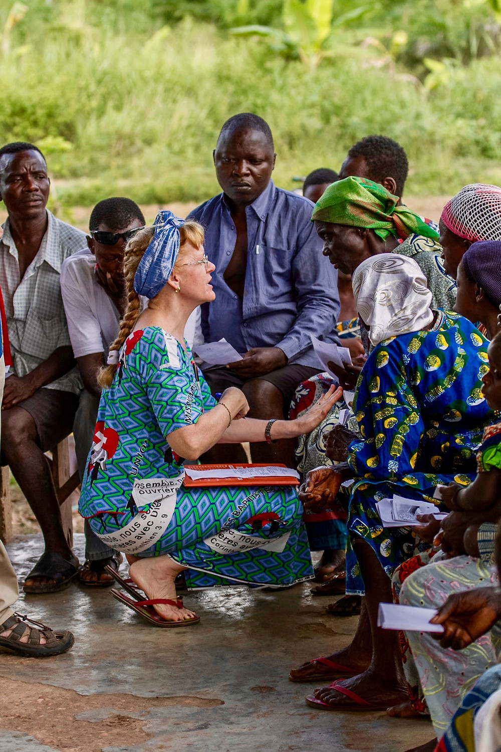 IMB missionary Barbara Singerman speaks with an Ayizo woman while writing down symptoms during a medical clinic in Benin. The clinic's purpose was to meet medical needs and open opportunities for evangelization and church planting. (IMB Photo)